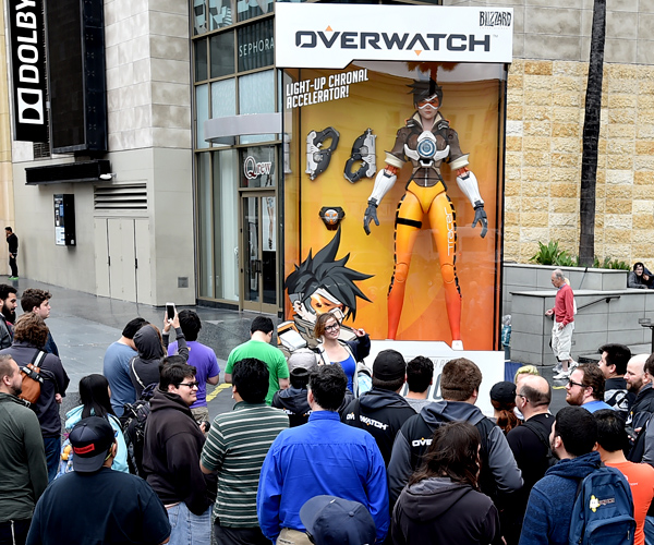IMAGE DISTRIBUTED FOR BLIZZARD - Overwatch fans crowd in front of the world's largest Tracer action figure on Hollywood Blvd. on Friday, May 20, 2016, in Los Angeles. Overwatch launches on PS4, Xbox One and PC on May 24th. (Jordan Strauss/AP Images for Blizzard)